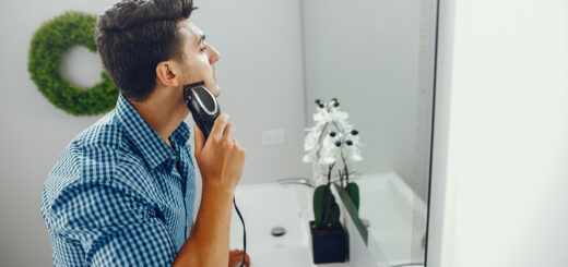 man is shaving his face using the best electric shaver for men