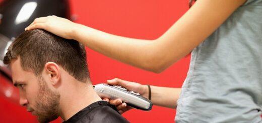 a woman cutting a man's hair