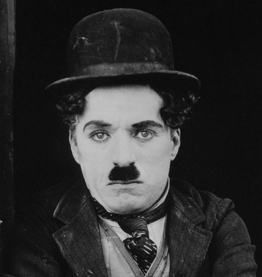 a black and white image of charlie chaplin