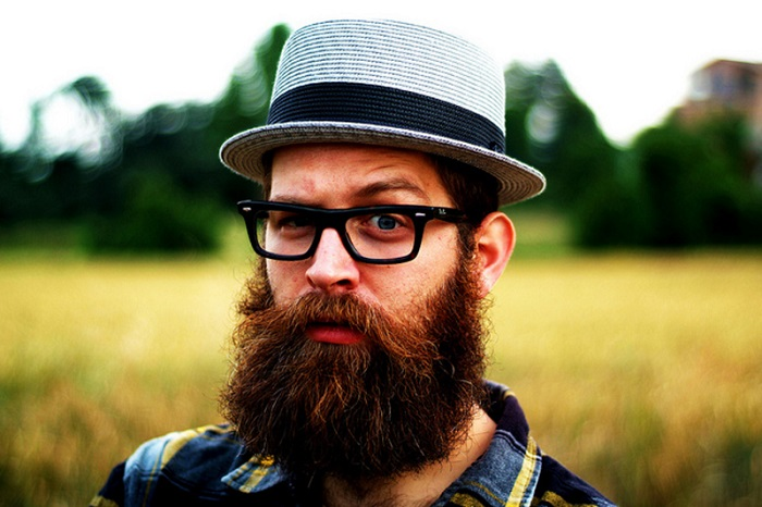 a hipster man with long beard