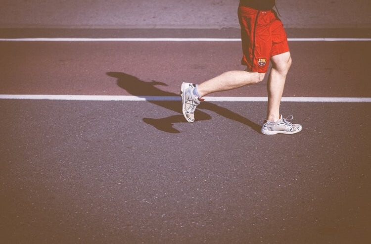 a man's legs while he jogs