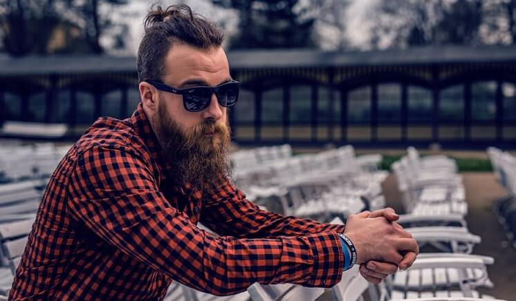 a stylish man with beard and glasses