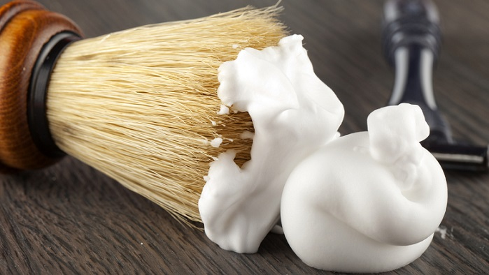 a shaving brush with foam on it