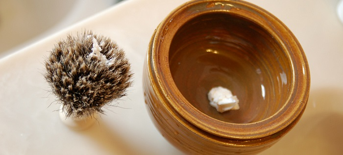 a shaving scuttle bowl and a brush