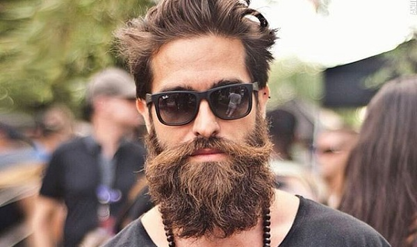 a cool male hipster wearing sunglasses