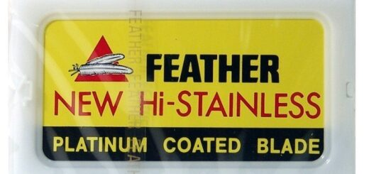 a yellow packaging of Feather razor blades