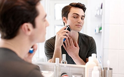 man shaving in the bathroom with Philips Norelco Shaver 4500