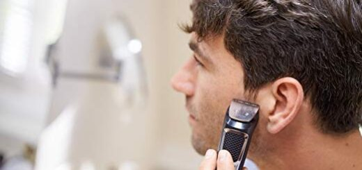 man using philips norelco shaver
